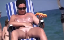 Voyeur films nude amateur chicks at the beach