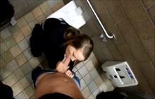 Mya Lane blowing a cock in public toilet