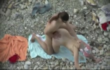 Naughty couple fucking hard on the beach
