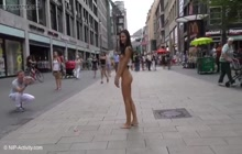Completely nude girl walking on a street