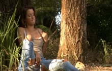 Babe masturbating on a park bench